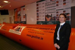 Ann Tracy pictured with the Inflatable Flood Barriers